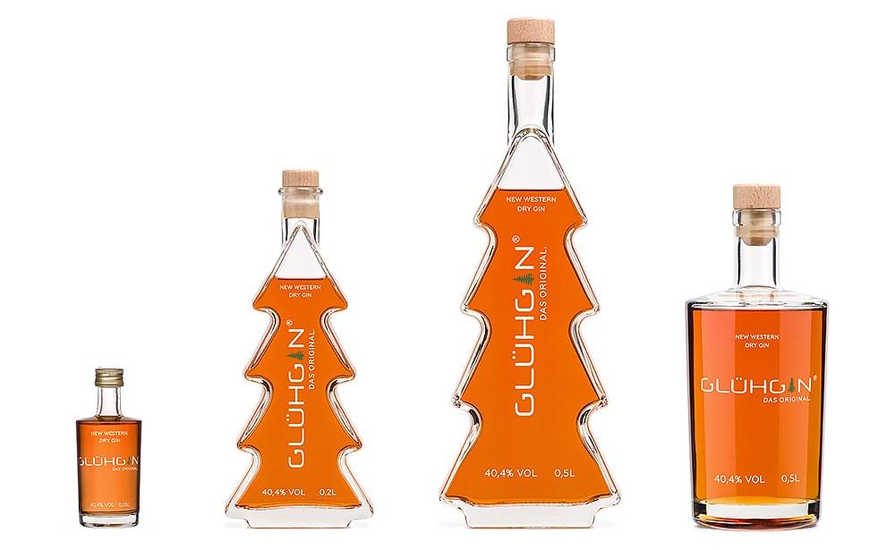 Glühgin in vier Flaschen Designs. Der heißeste Gin des Jahres. Glüh Gin ist sehr lecker.